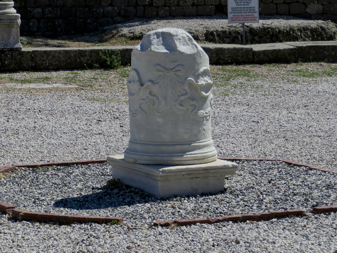 two snakes on marble column